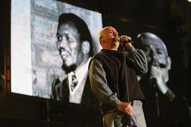 Peter Gabriel performs Biko at the Give One Minute of Your Life to AIDS in Cape Town in 2003 (Frank Micelotta/Getty Images)